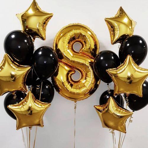 Офрмить день рождения золотыми и чёрными шарами